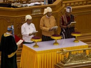 Htin Kyaw, second right, takes oaths as Myanmar's new president during a sworn-in ceremony in Myanmar's parliament in Naypyitaw