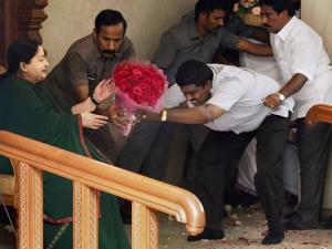 Tamil Nadu Chief Minister and AIADMK Supremo J Jayalalithaa is greeted by a party cadre after the party's win in the state Assembly polls, in Chennai