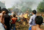 People looking at the wreackage of a Jaguar fighter plane that crashed