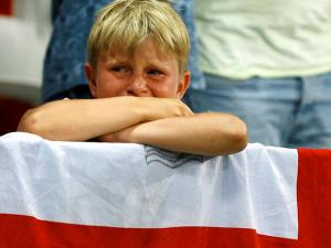 A young England fan cries at the end of the Euro 2016