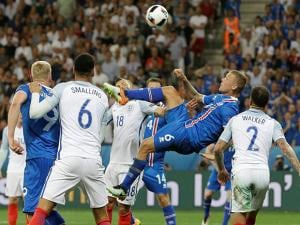 Iceland's Ragnar Sigurdsson goes for an acrobatic shot during the Euro 2016