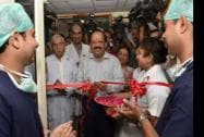 Union Minister for Health and Family Welfare Harsh Vardhan cutting a ribbon