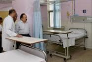 Union Minister for Health and Family Welfare Harsh Vardhan interacts with doctors while inspecting a ward