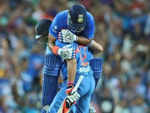 Indian batsman suresh raina top, and yuvraj singh celebrate