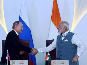 Narendra Modi shakes hands with Russian President Vladimir Putin