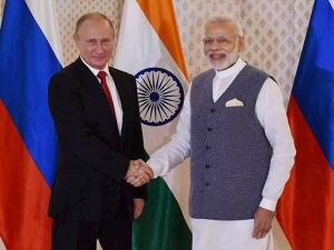Vladimir Putin being welcomed by Prime Minister Narendra Modi