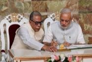 Prime Minister Narendra Modi signs the Visitors Book