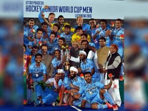 Uttar Pradesh Governor Ram Naik presents the Junior World Cup Hockey trophy to Indian team after their victory over Belgium in Lucknow