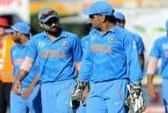 Indian captain MS Dhoni. right, walks with teammate Virat Kohli