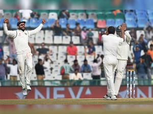 Indian captain Virat Kohli and Mohammed Shami celebrate the wicket of England batsman Chris Woakes