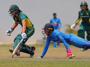 South Africa's Dane van Niekerk completes a run as India's Sushma Verma attempts to field the ball