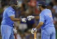 India's M S Dhoni, and teammate Ravichandran Ashwin talk