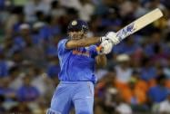 M S Dhoni watches his shot during their Cricket World Cup Pool B match