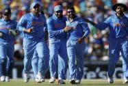 Ravindra Jadeja, second right, is congratulated by teammates after dismissing West Indies batsman Andre Russell