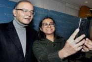 An unidentified woman takes a selfie with Arun Jaitley