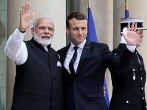French President Emmanuel Macron welcomes Indian Prime Minister Narendra Modi