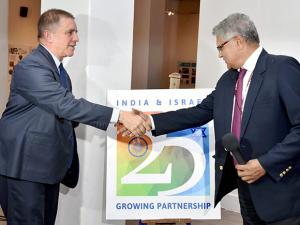 Amar Sinha, Secretary (ER) and lsraeli Ambassador to India,  Daniel Carmon shake hands