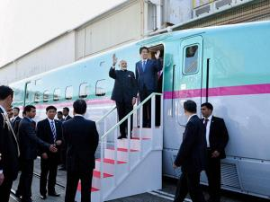 Narendra Modi sits on pilot seat of a bullet train as his Japanese counterpart Shinzo Abe