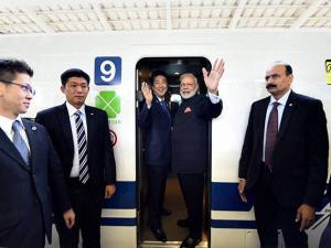 Narendra Modi and his Japanese counterpart Shinzo Abe boarding the Shinkansen