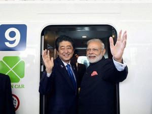 Narendra Modi and his Japanese counterpart Shinzo Abe boarding the Shinkansen bullet train