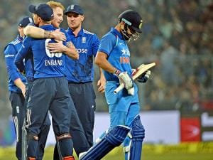 England bowler BA Stokes jubiliate with his teammates after dismissed Indian captain Virat Kohli