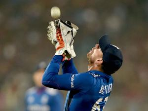 England wicketkeeper JC Buttler takes a high catch of Indian batsman Lokesh Rahul to dismissed him