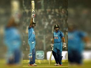 Indian batsman Hardik Pandya acknowledging crowds after complete his half century as other batsmanm Kedar Jadhav  looks