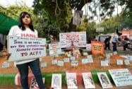 A girl holding a placard on the  second anniversary of the deadly gang rape