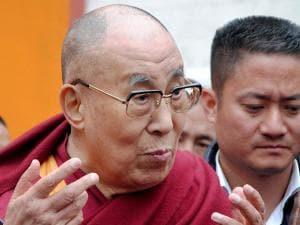Tibetan spiritual leader Dalai Lama interacting with media after a spiritual discourse