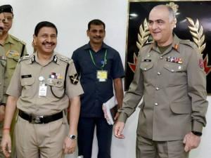 BSF Director General D.K. Pathak and Pakistani Rangers Director General Umar Farooq Burki