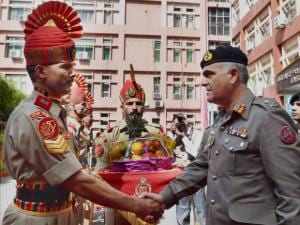 Pakistani Rangers Director General Umar Farooq Burki shakes hands with a BSF jawan