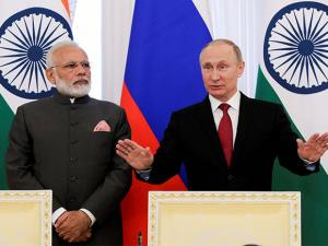 Prime Minister Narendra Modi and Russian President Vladimir Putin speak to the media