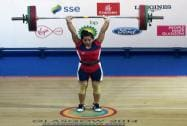 India's Chanu Saikhom completes a lift during the 48-kg women's weightlifting