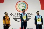 India's Gold medal winner Sukhen Dey and Bronze medal winner Ganesh Mali with silver medal winner Malaysia's Zulhelm MD Pisol pose