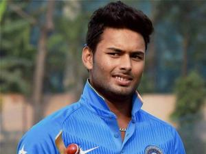 Cricketer Rishab Pant with man of the series trophy