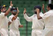 Ravichandran Ashwin, celebrates with teammates Virat Kohli, left, Ajinkya Rahane