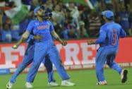India's Virat Kohli, celebrates after taking a catch to dismiss Pakistan's Shahid Afridi