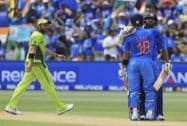 Pakistan's Shahid Afridi, left, watches India's Virat Kohli, back to camera congratulate teammate Shikhar Dhawan
