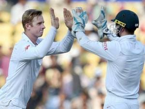 South African bowler Harmer celebrates the wicket of Indian batsman Amit Mishra