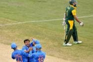 Indian player's celebrate after dismissing South African batsman Hashim Amla