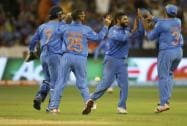 Indian players celebrate the wicket of South Africa's A.B. de Villiers