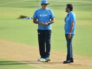 Indian cricket team director Ravi Shastri (L) and chief selector Sandeep patil taking a look at the pitch at a practice session of the Indian cricket team ahead of the ICC World T20 semifinal matc