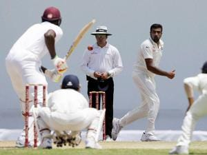 India's Ravichandran Ashwin, right, bowls against West Indies