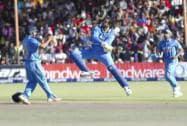 Robin Uthappa, celebrates the wicket of Zimbabwean batsman Sikandar Butt Raza