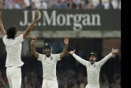 India's Cheteshwar Pujara celebrates catching out Moeen Ali off an Ishant Sharma