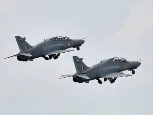 Two advanced jet trainer Hawks  showcase the flying training as a part of a show at Kalaikunda airbase in West Midnapore district of Bengal