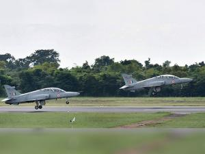 Two advanced jet trainer Hawks take off as a part of a show at Kalaikunda airbase