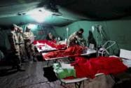 Army personnel attending injured victims at a field hospital during their rescue operation in earthquake-hit Nepal