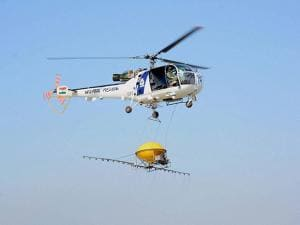 Indian coast guard chopper demonstrates the procedure incase of an oil fire disaster