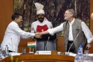 Delhi Lt Governor Najeeb Jung and Chief Minister Arvind Kejriwal shake hands